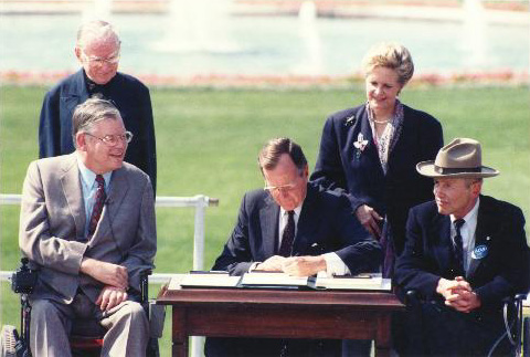 Pres. George H.W. Bush signing the ADA into law in July 1990